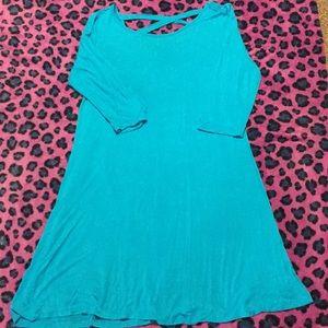 Blue scoop neck, knee length dress.